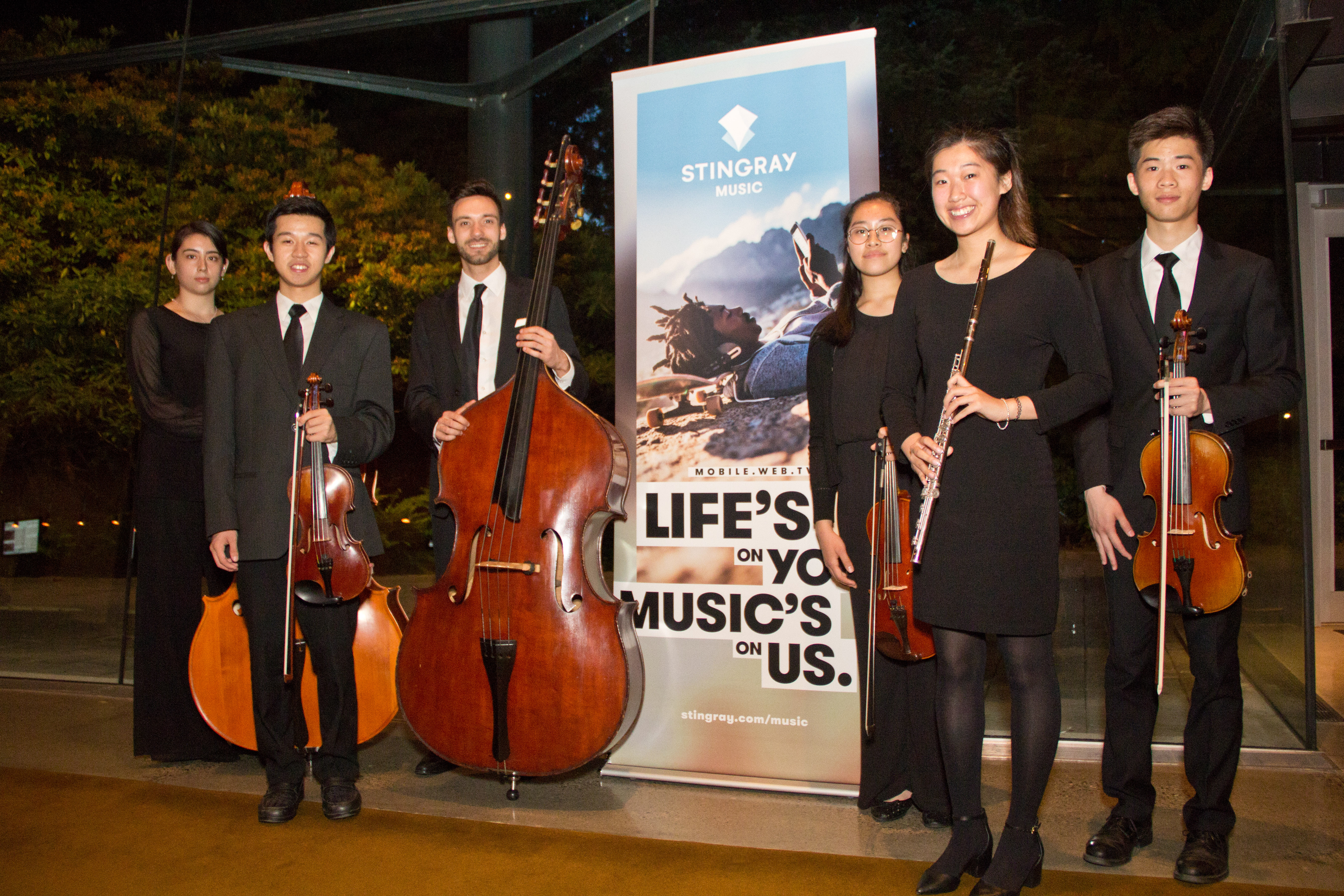 From left to right: Naomie Okubo-Champoux (double bass), Jeremy Ho (violin), Jacques Forest (double bass), Britney Do (viola), Kelly Li (flute) and Chris Lu (viola).  Photo credit: Matthew Baird, VSOI